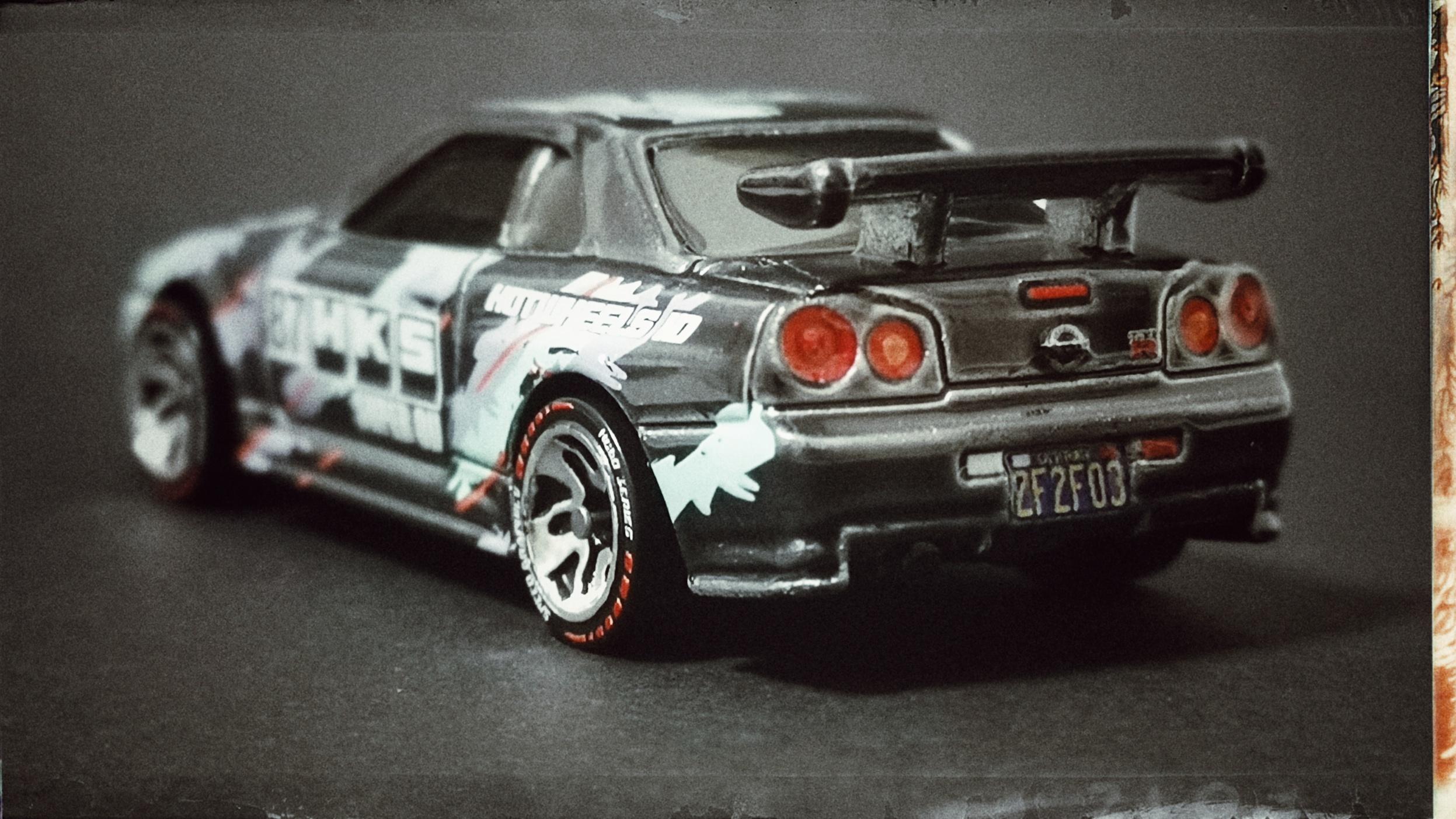 Hot Wheels id Nissan Skyline GT-R (R34) (HBG07) 2021 HW Speed Graphics (03/04) spectraflame black back angle