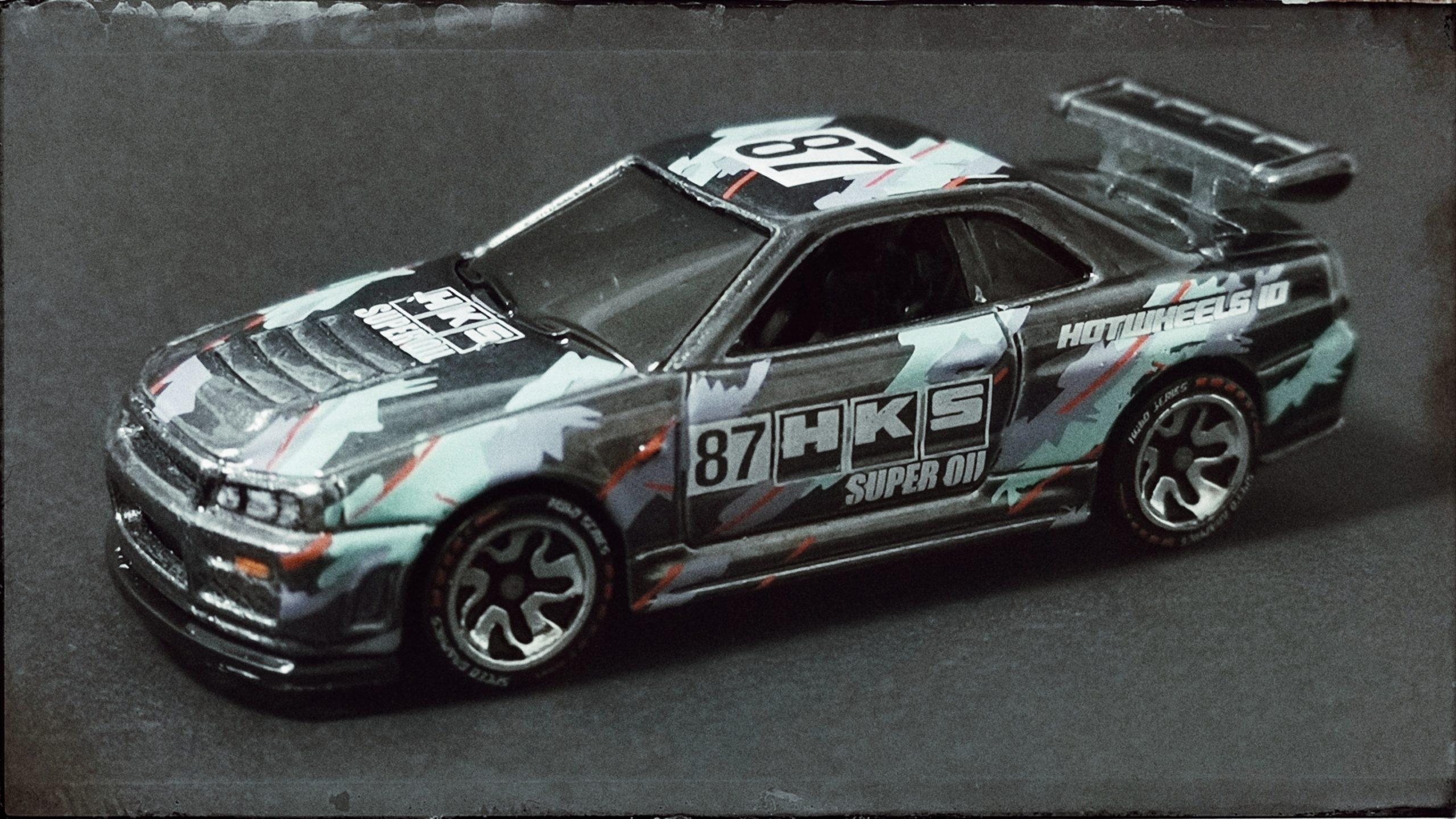 Hot Wheels id Nissan Skyline GT-R (R34) (HBG07) 2021 HW Speed Graphics (03/04) spectraflame black side angle