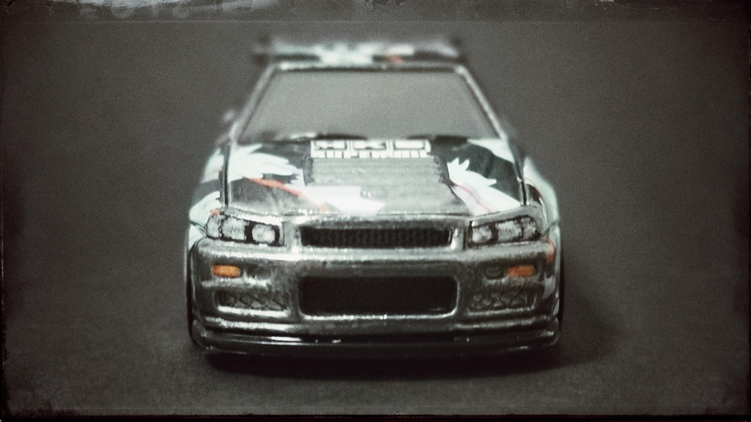 Hot Wheels id Nissan Skyline GT-R (R34) (HBG07) 2021 HW Speed Graphics (03/04) spectraflame black front