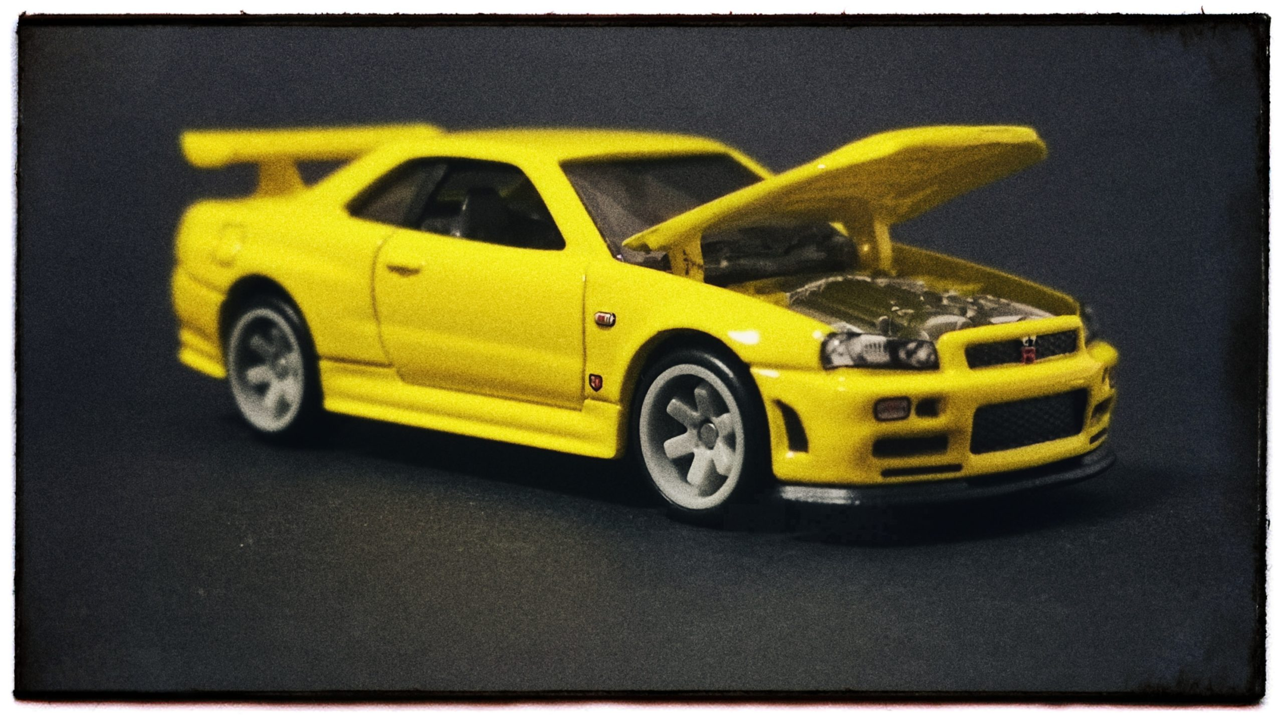 Hot Wheels 33rd Annual Collectors Convention Nissan Skyline GT-R (R34) 2019 yellow front angle