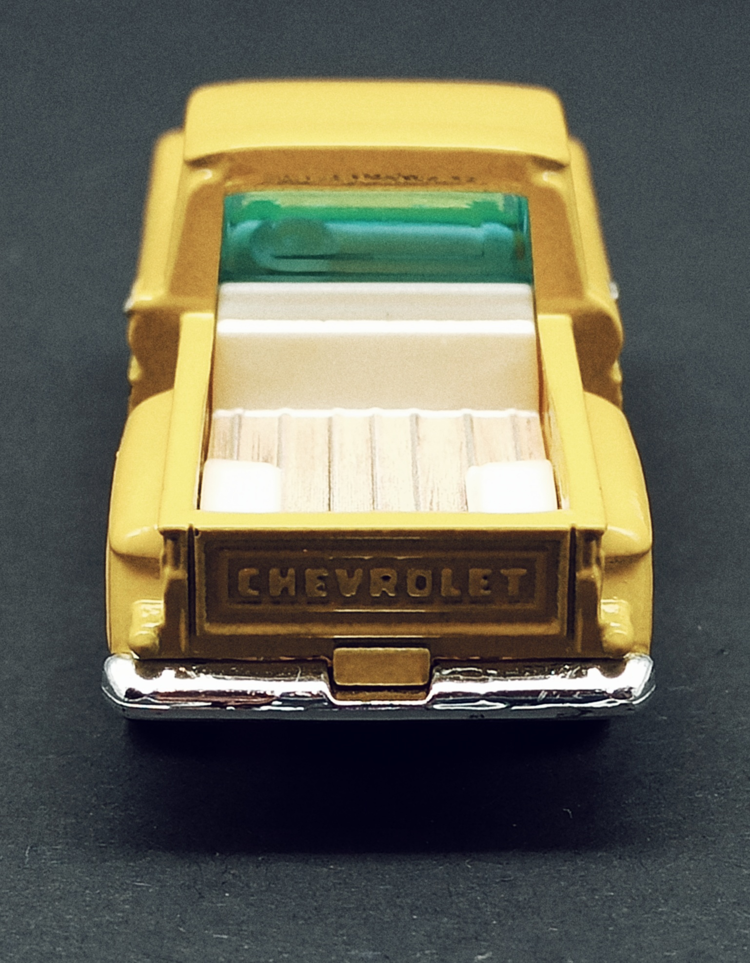 Matchbox Collectors Series '63 Chevy C10 Pickup Truck 1963 (GRK24) 2021 (3/20) yellow (Mooneyes) back view