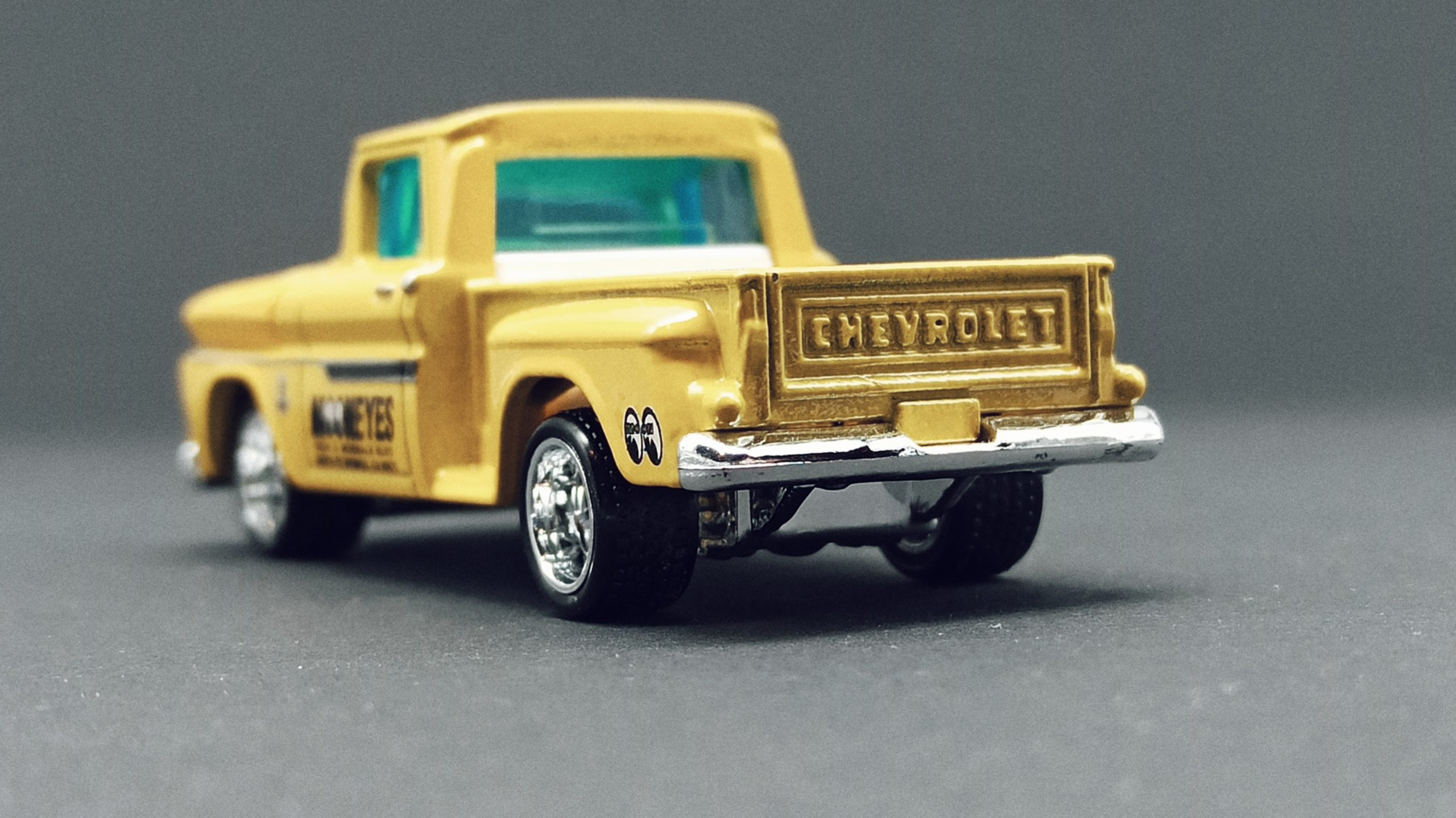 Matchbox Collectors Series '63 Chevy C10 Pickup Truck 1963 (GRK24) 2021 (3/20) yellow (Mooneyes) back angle