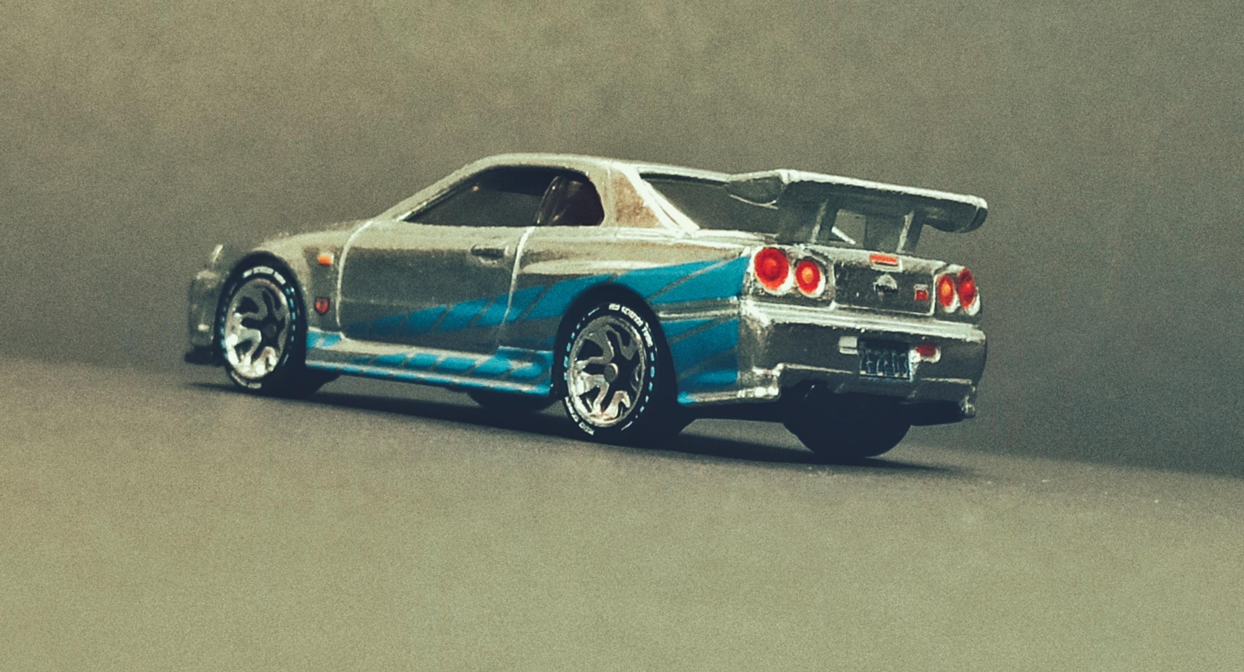 Hot Wheels id Nissan Skyline GT-R (R34) (HCJ08) 2021 HW Screen Time (01/03) zamac side angle