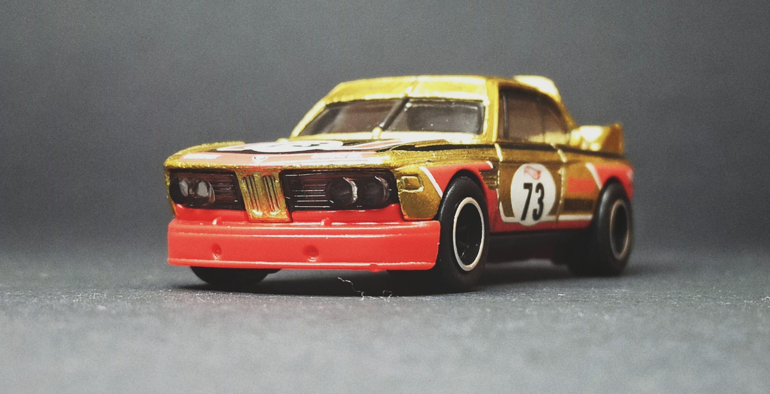 Hot Wheels '73 BMW 3.0 CSL Race Car (HCY20) 2022 (34/250) Retro Racers (2/10) spectraflame yellow (gold) Super Treasure Hunt (STH) front angle