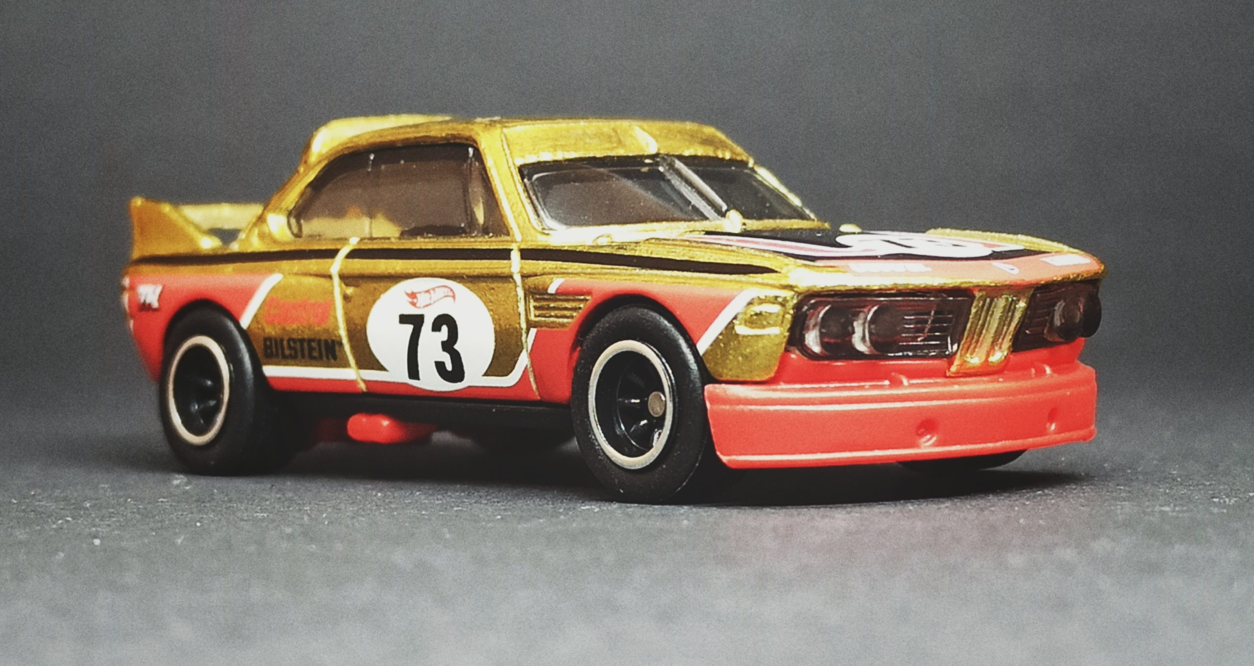 Hot Wheels '73 BMW 3.0 CSL Race Car (HCY20) 2022 (34/250) Retro Racers (2/10) spectraflame yellow (gold) Super Treasure Hunt (STH) side angle